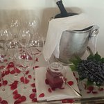 make a prosecco berry drink for breakfast, among rose petals
