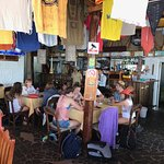 Rosita Bar Restaurant interior w/ample seating. T-shirts/flags handing from ceiling.