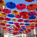 Colourful umbrellas providing some shade in the centre of Bath