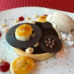 Chocolate peanut butter tarte with rum ice cream and peanut butter powder