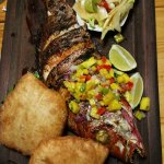 Grilled fish of the day wth green Papaya salad and Arepas
