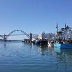 Newport bridge and boats offloading fish