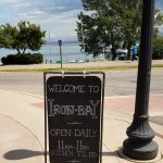 welcome sidewalk sign - see the lake in the background
