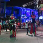 entertainers on stilts after dark