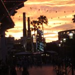 View across river to Hardrock and Chocolate Emporium at sunset