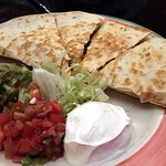 Chicken Quesadilla (chicken, cheese, peppers, lettuce, pico de gallo, sour cream, and guacamole)