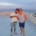 Bartender extraordinaire ADOLFO and me on the roof at sunset. The colors were stunning.