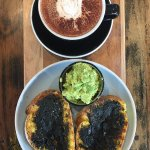 Hot chocolate and veganmite with cheese (with no cheese) and a side of smashed Avo