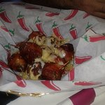 bacon wrapped tater tots with jalepenos stuffed inside and cheese, comes with ranch for dipping.