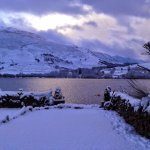 Petanque piste in the snow, garden Loch Earn