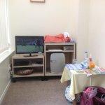 Conservatory showing tv and mini fridge,