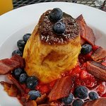 French toast with fresh strawberries and blueberries and local bacon