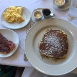 Hearty pancakes, bacon and scrambled eggs.