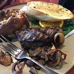 Sizzler with mashed potatoes, garlic toast and a side order of onions and mushrooms.