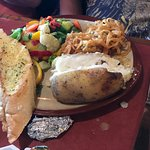 Saturday night special: blue cheese sizzler with, baked potato, garlic bread and mixed vegetable