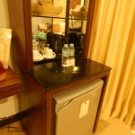 "Rooms all come with a Bar-Type Refrigerator and, two bottles of ""free"" complementary water."