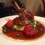 Lamb Shank with Minted Peas, Truffled Mash, Vine Ripened Tomatoes, Jus