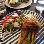 Front: Open porterhouse steak sandwich (minus cheese & mayo), back: Eggs Benedict