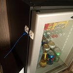 "The room's personal ref/mini-bar is ""well secured"". Odd indeed!"