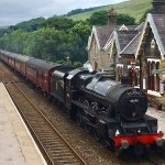 Leander steam train at speed through Settle Station