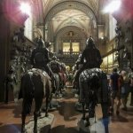 A huge long room with armour going through the ages