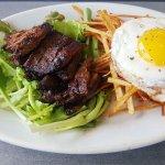 """Brunch menu steak and eggs (served on weekends at """"Debut"""" next door)"""