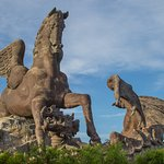 Pegasus defeating dragon, 100 ft. tall statue - sidewalk exit view