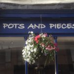 Hanging baskets add to a beautiful High Street