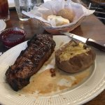 Jack Daniels strip steak and baked potato wit a yeast roll and house made strawberry jelly. ❤️