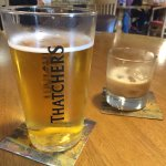 A pint of Thatchers Gold and a glass of Cotswold Creme Liquor