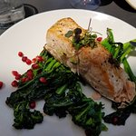 Salmon with rapini and pomegranate