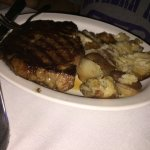 Medium ribeye with herbed butter red potatoes.