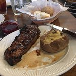 Jack Daniels Marinated Steak, Baked Potato, Yeast Roll and house made strawberry jelly.