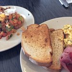 Bruschetta and scrambled eggs with bacon