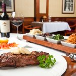 Certified Angus Beef Striploin served with our Signature Vegetable Board