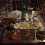 Kingfisher beer, Papadums, Naan bread, rice, butter chicken, Black Lentils & Lamb curry
