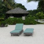 Our bungalow, beach furniture and hammock.