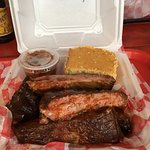 1/2 rack of ribs with candied yams and corn bread