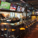 Open for breakfast, lunch, and dinner, grab a bite or catch a game in Champions Sports Bar & Gri