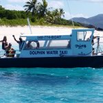 """Trixy"" passing by tiny Sandy Cay in the BVI"