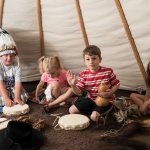 Kids playing in the Plains Indian Tipi