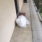 TOWEL bag blocking door and TRASH old suitcase next door for my entire stay