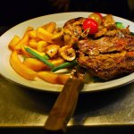 Lovely steak with chunky chips, onion, tomato and mushroom ragout.