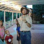 Our guide giving instructions on how to hold a baby gator and baby croc.