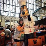 Getting hugs from Goofy!
