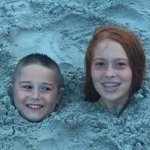 BEACH KIDS KEEPING COOL IN THE SAND :)