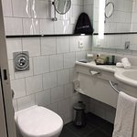 Nice clean bathroom with small bath/shower combination