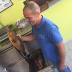 Our waiter with fish caught that day!
