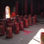 Very large candles burning inside the temple