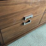 Oil or lotion handprints and residue on dresser